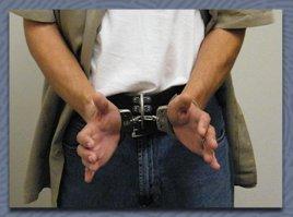 Prisoner handcuffed around waist