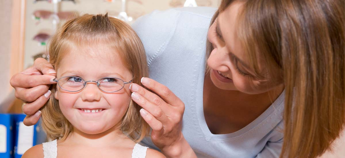 girl, child trying on glasses