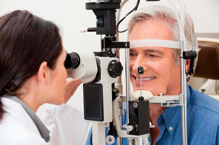 man having eyes tested, optometrist