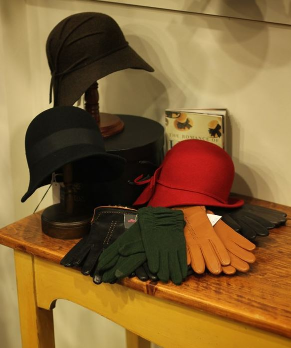 Hats and gloves arranged on a table