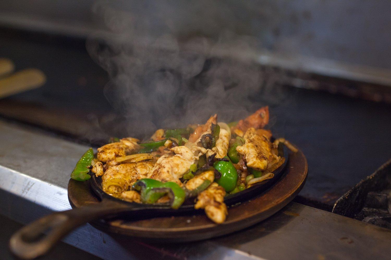 Cozumel Grill Mexican Restaurant chicken fajitas on a skillet