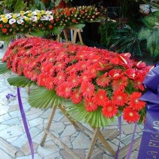 cuscino funebre di gerbere rosse
