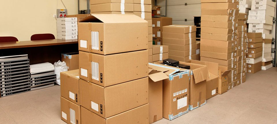 Boxes stacked in a storage facility