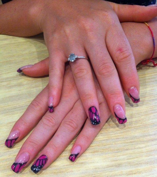 ricostruzione unghie viola con disegni