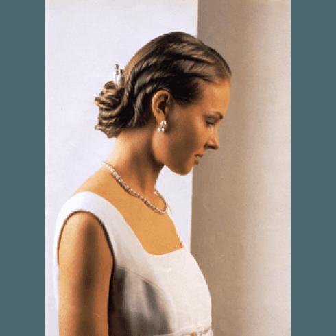 acconciatura sposa con trecce legate