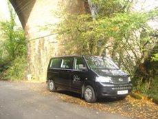 our black minibus under a viaduct