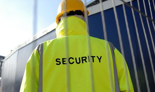 A security guard in high visibility gear