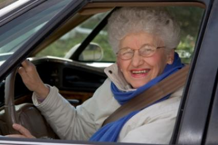 A happy senior after a successful driving lesson at City Driving School in Montreal