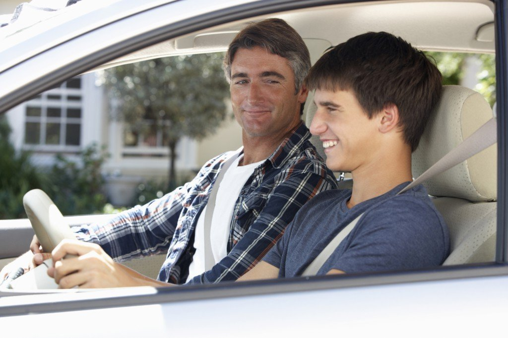 Father and son on outing with City Driving School's exclusive learner / accompanying rider program