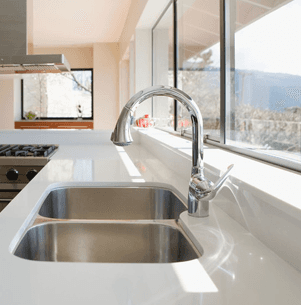 double sink with mixer tap, set in polished resin worktop