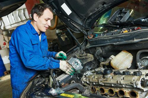 Automobile salvage expert repairing a car in O'Fallon, MO