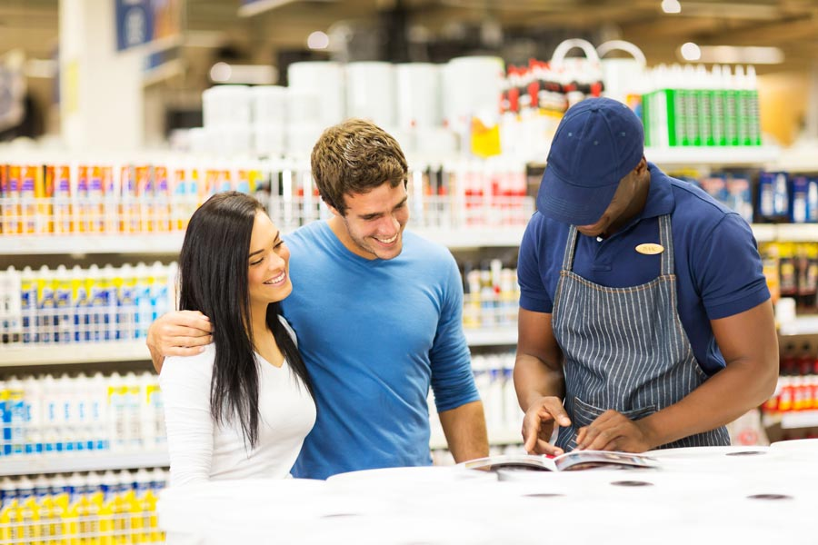 couple talking to worker at a hardware store