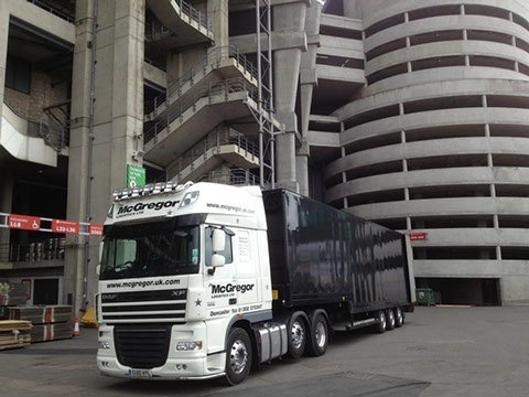 haulage vehicle infront of a building