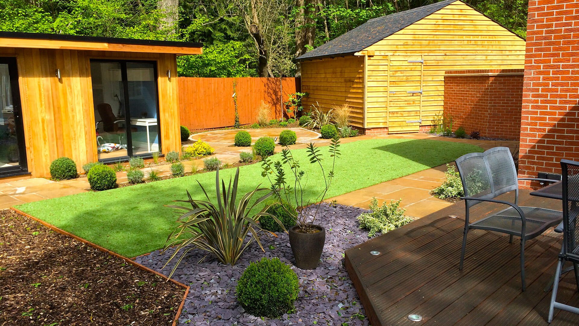 modern back yard garden with green space and paved alleys