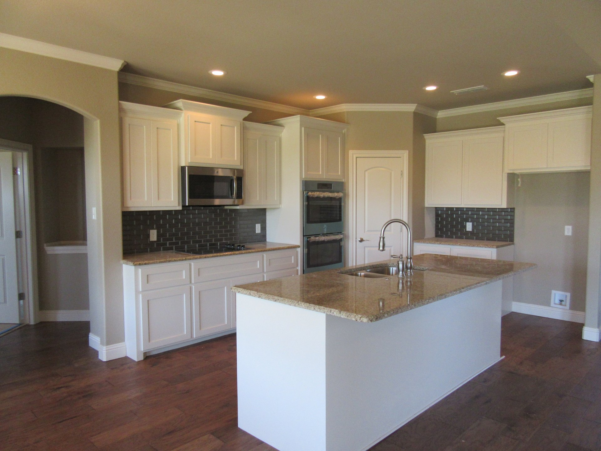 kitchen with granite countertops in new home built by cornerstone custom homes