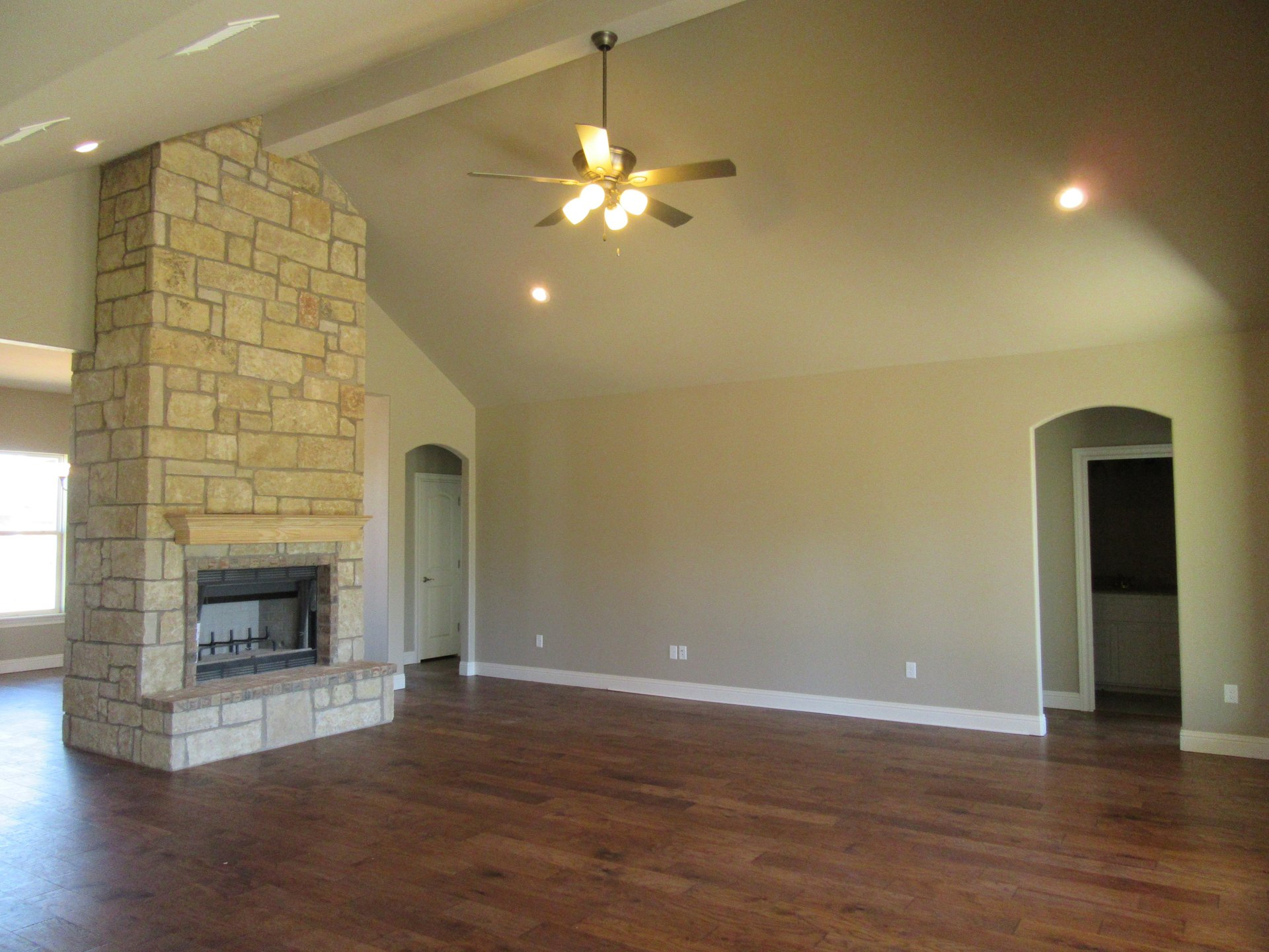 living room with fireplace in new home built by Cornerstone Custom Homes