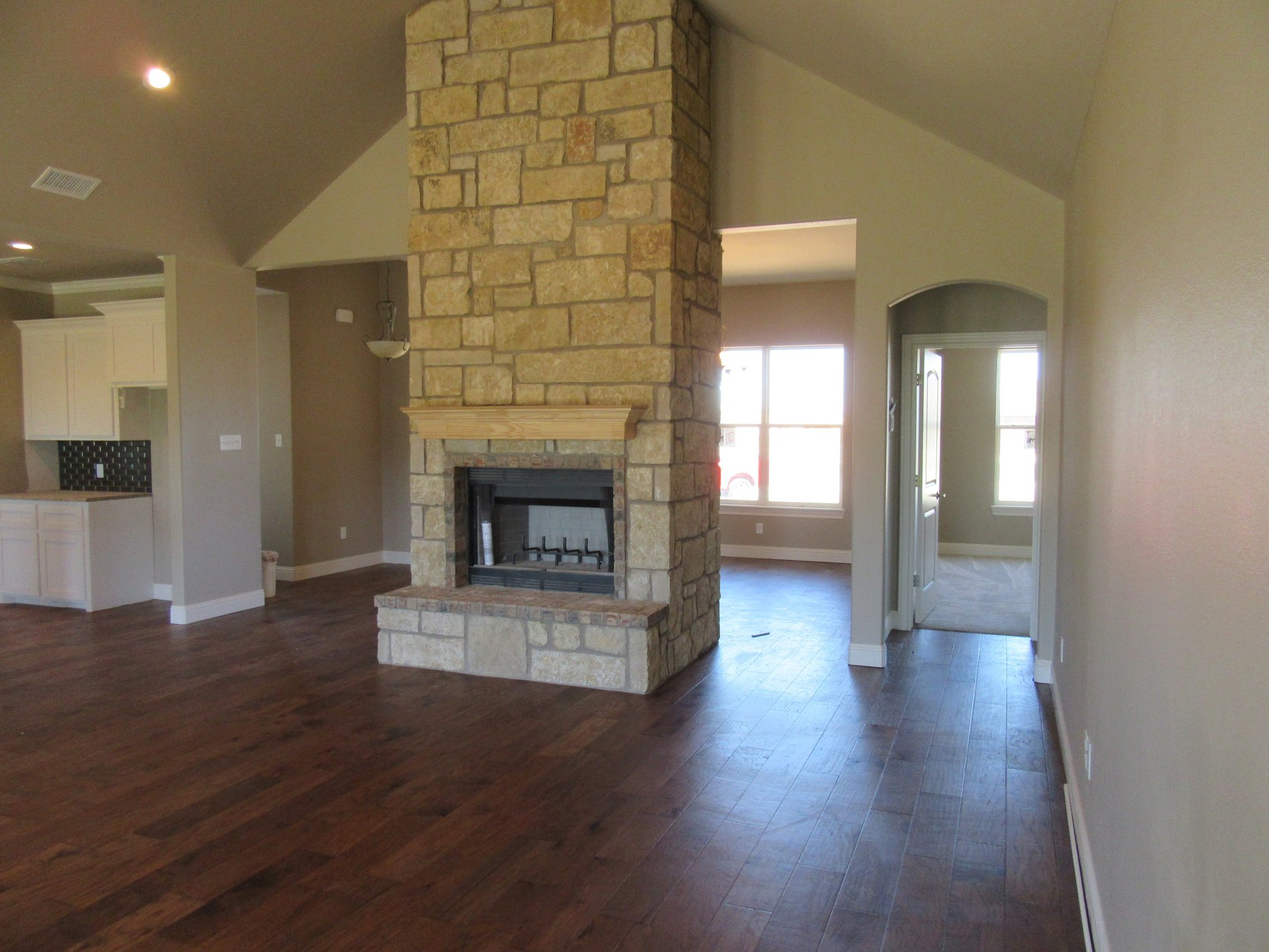fireplace in living area in new home built by cornerstone custom homes
