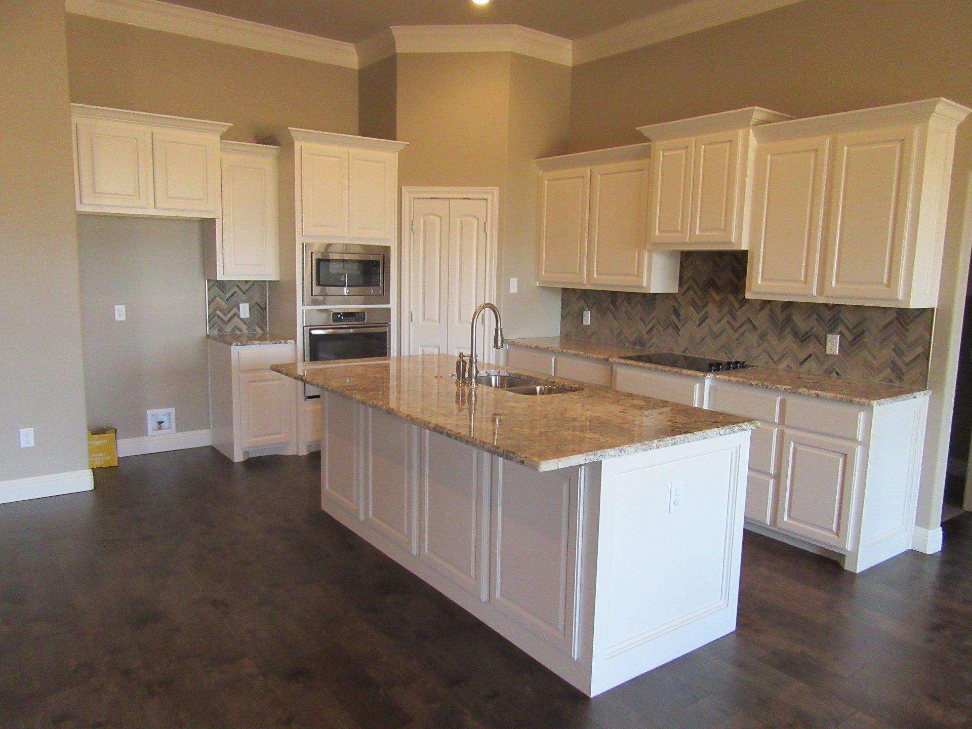 kitchen with white cabinets in new home built by cornerstone custom homes