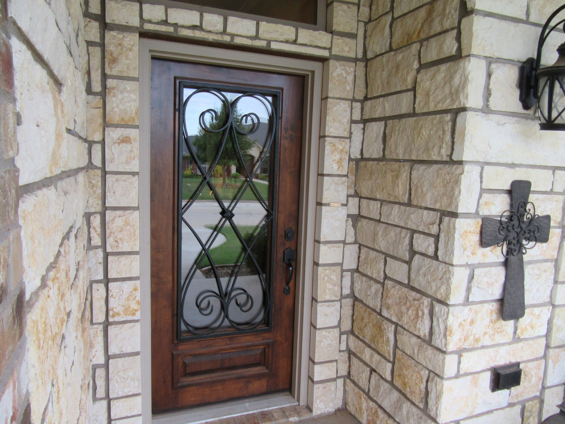 door with wrought iron decoration on new home built by cornerstone custom homes