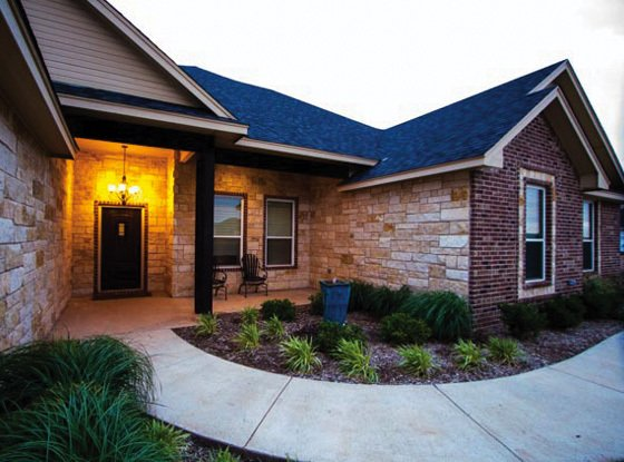 stone and brick home built by cornerstone custom homes