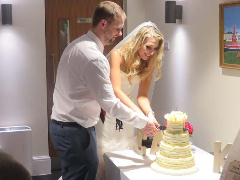 Couple cutting a cake in Lancashire