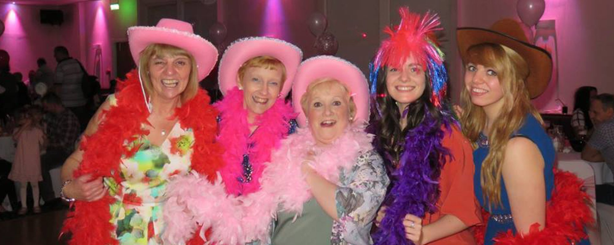 Group of women wearing party props and enjoying
