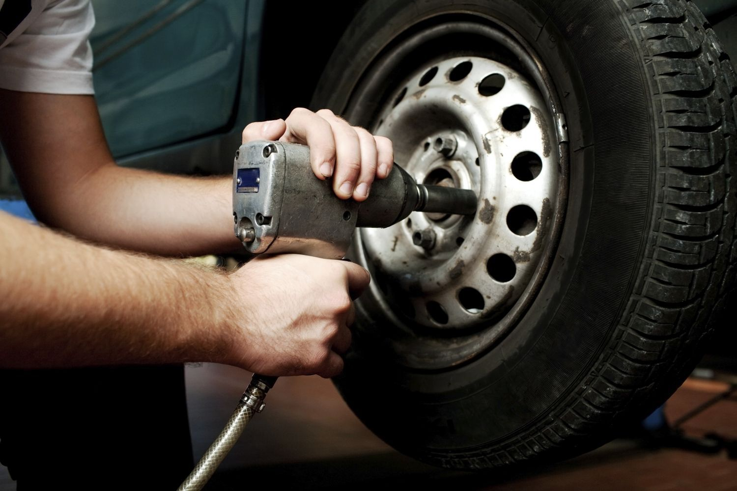 One of our mechanics fitting a tyre in an Auckland workshop