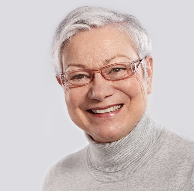 an elderly lady wearing spectacles