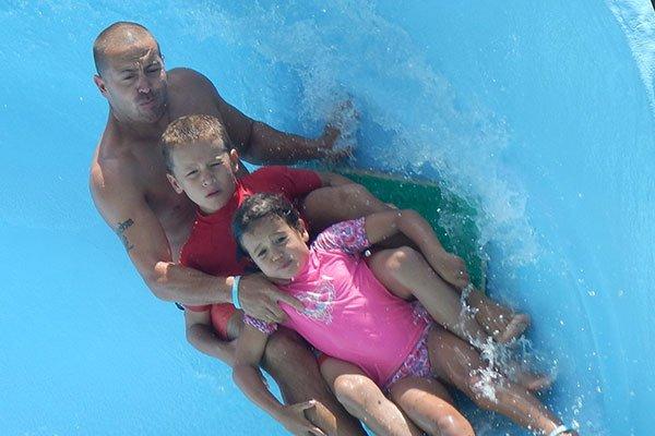 Family having fun at water slide