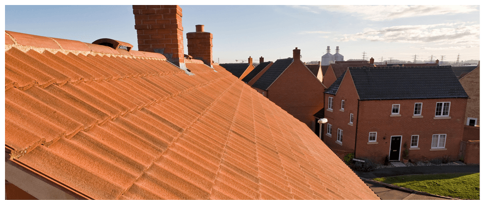 The view of a new roof, with other houses the background
