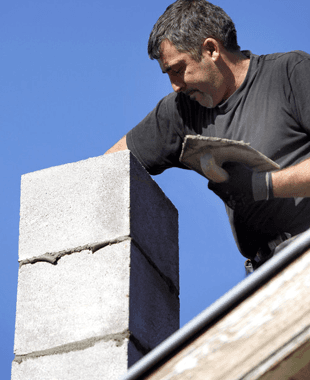 A man installing a new chimney