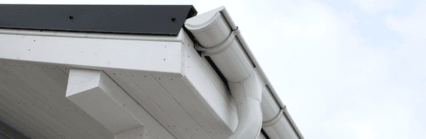 White guttering installed on a roof