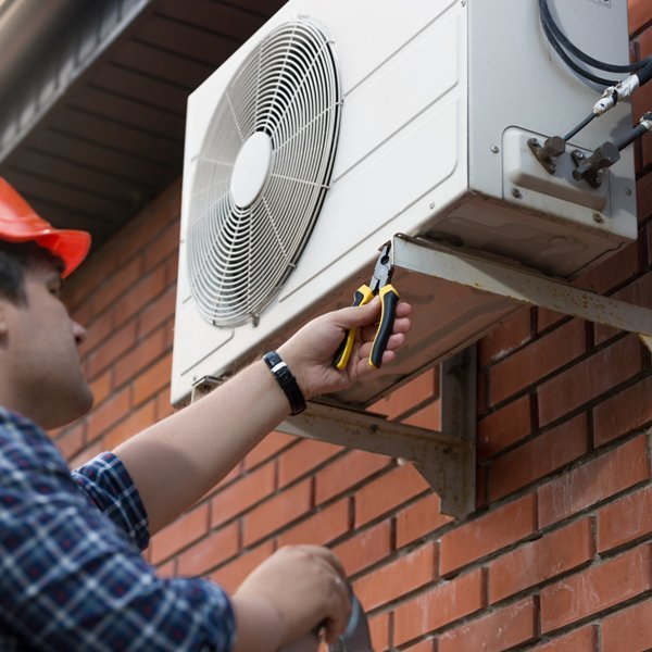 Split air conditioner being repaired