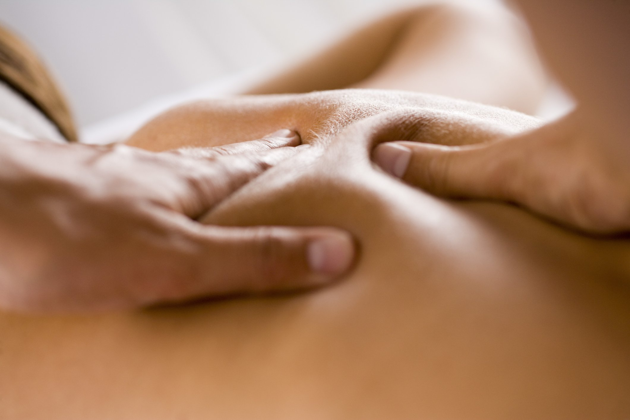 sore muscles massage hands back muscles