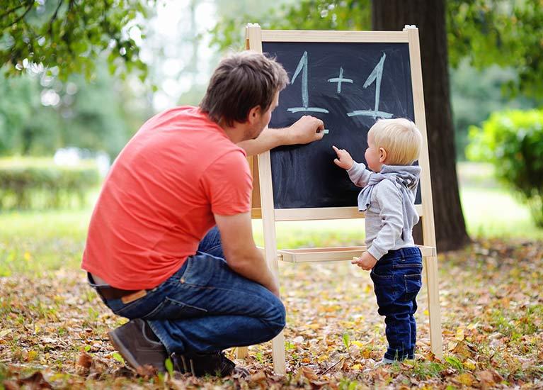 angela ferdinanady father teaching his son