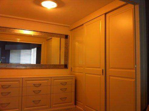 vinyl wrap walk in wardrobe with long horizontal mirror on wall