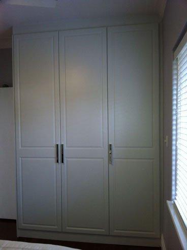 three tall vertical vinyl wrap hinged doors