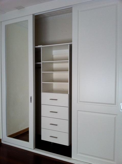 internal white shelving to built in wardrobe