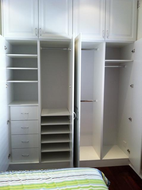 built in hinged vinyl wrap wardrobe with drawers and shelving