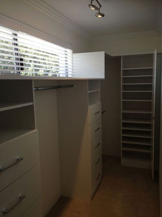 walk in wardrobe with small blinded window