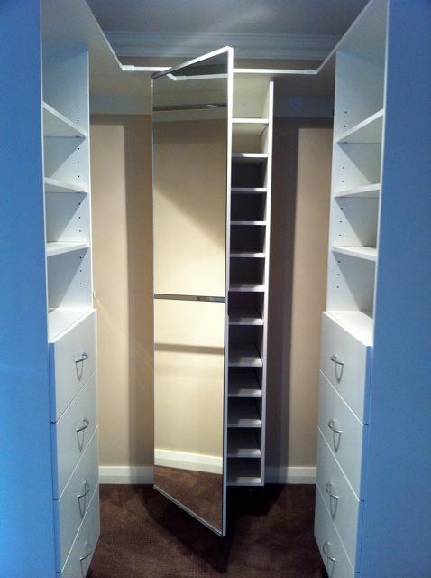 white internal shelving for walk in wardrobe including shoe storage
