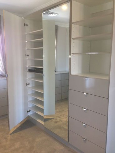 walk in wardrobe with gloss fronts