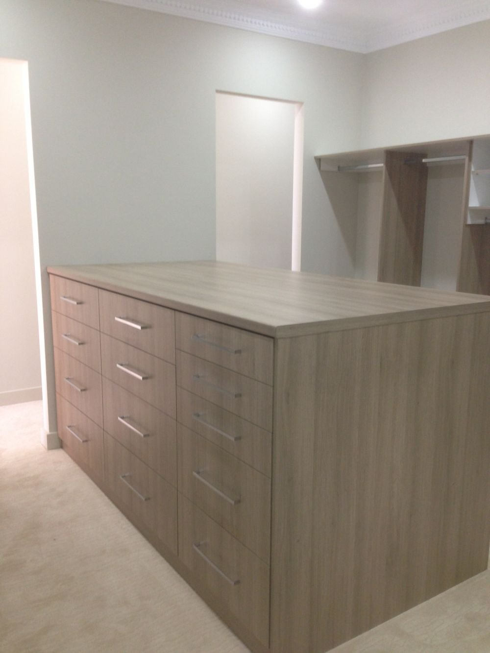 another angle of the island dresser in walk in wardrobe