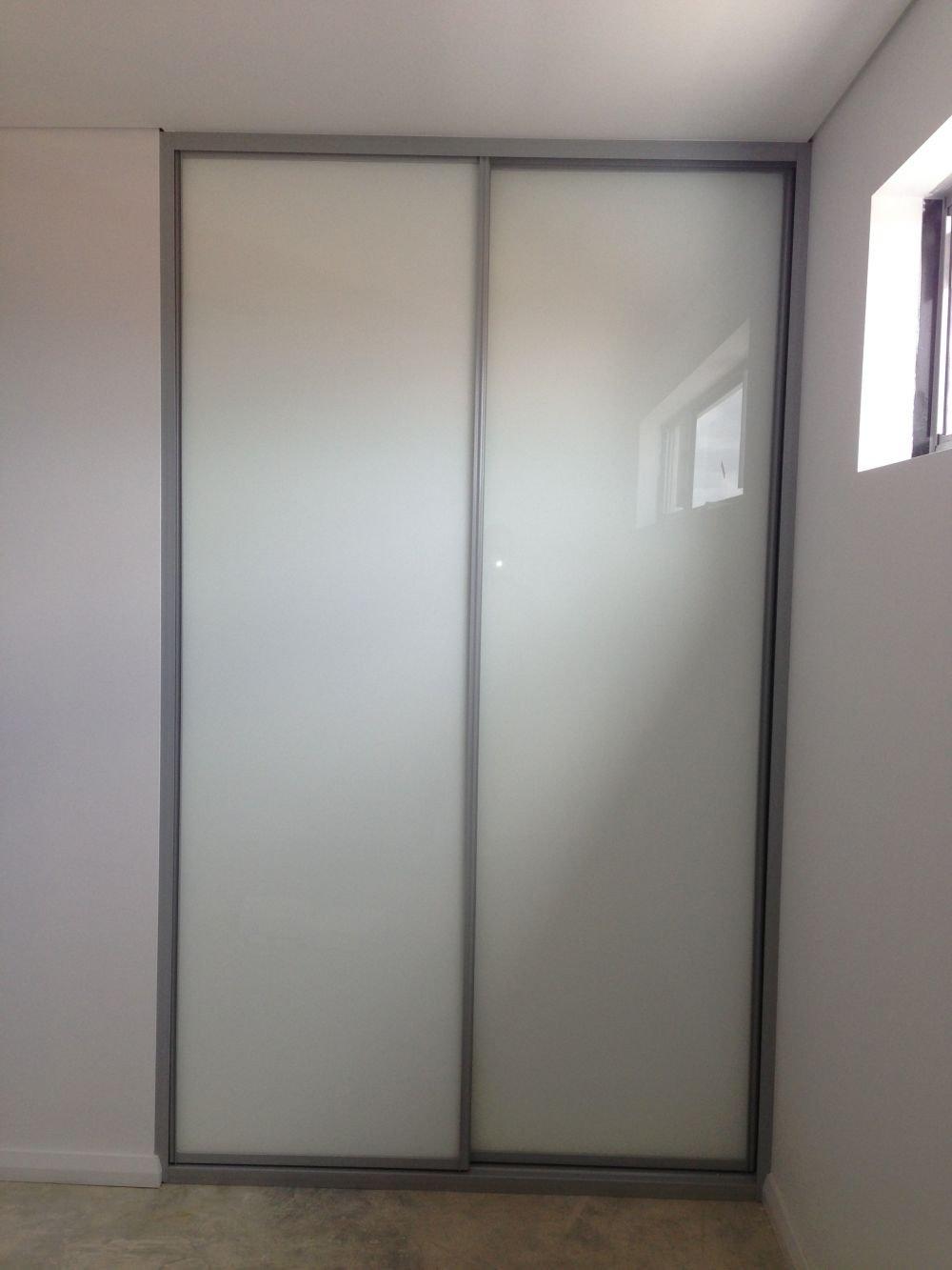 built in sliding wardrobe in white glass
