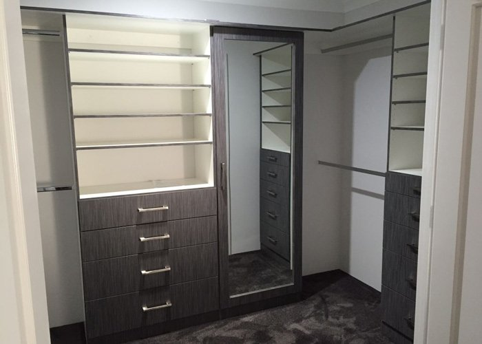wardrobe interior with mirror and stacked shelves