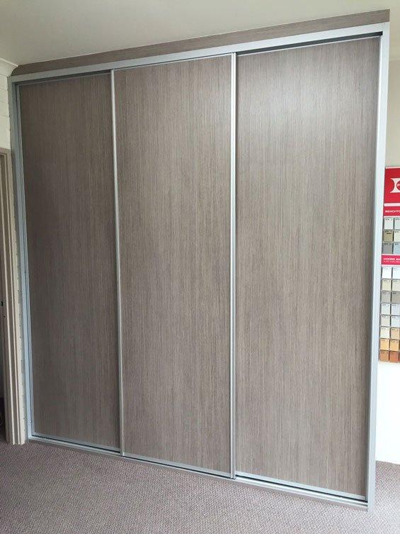 light brown 3 door sliding wardrobe
