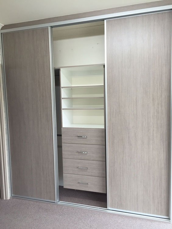 light brown sliding doors showing cupboards inside