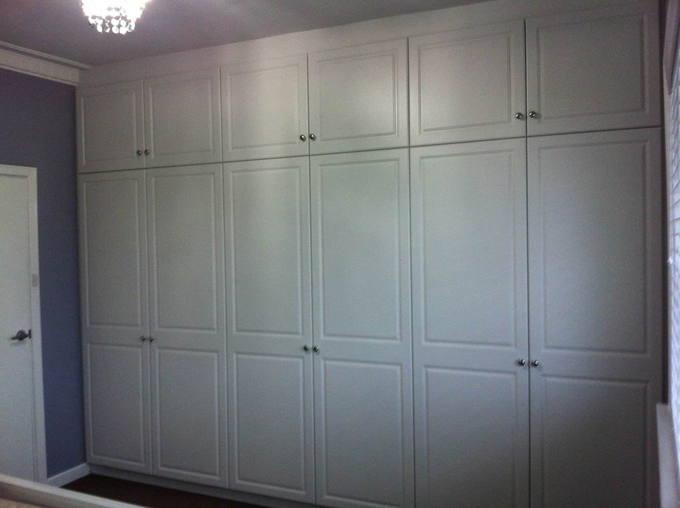 multiple white hinged door cubboards