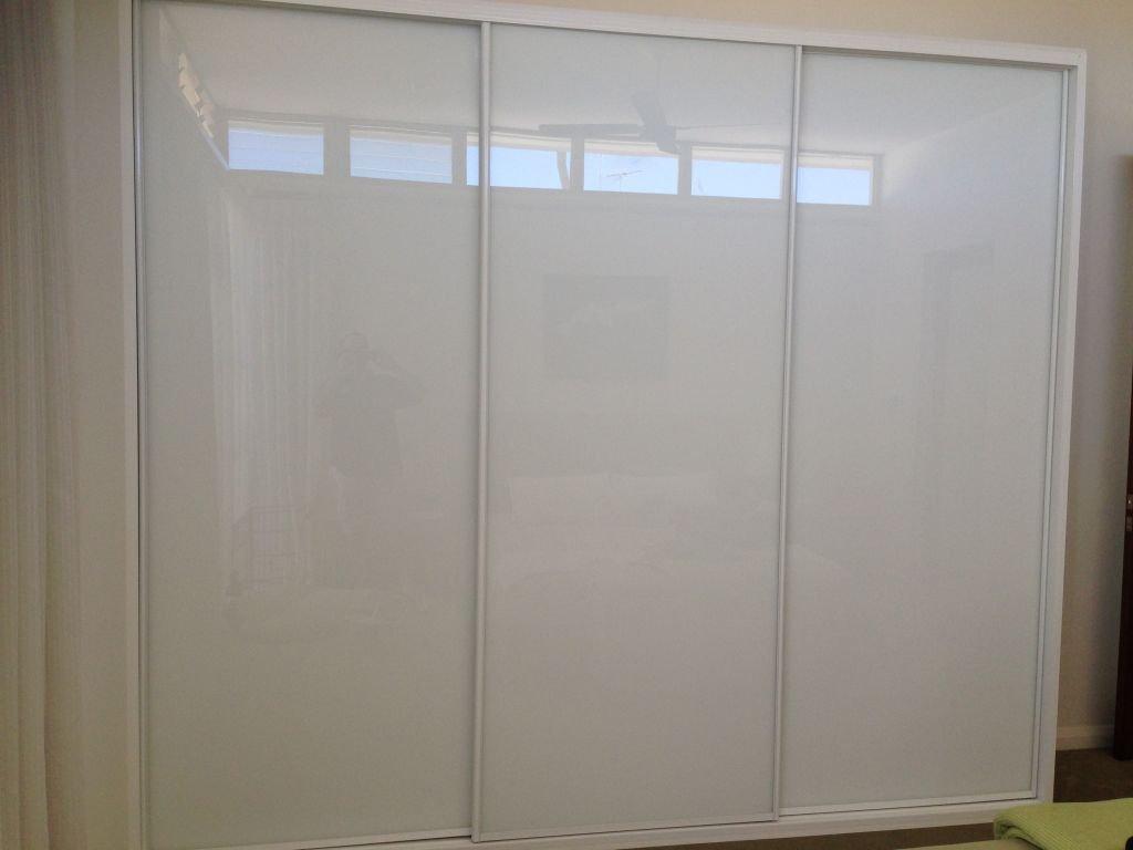 ultra white glass sliding wardrobe with white frame