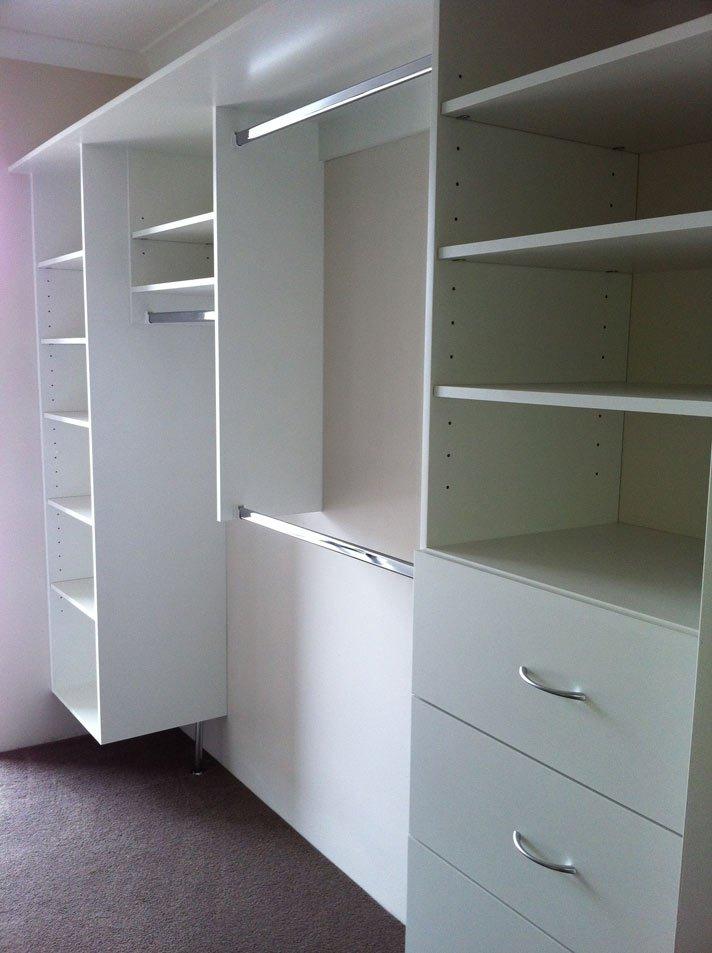 third view of white shelved walk in wardrobe